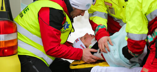 09.03.2014, Oslo, Norway (NOR): Astrid Jacobsen (NOR) crashed in a downhill and will be transported by the rescue crew- FIS world cup cross-country, mass women, Oslo (NOR). www.nordicfocus.com. © Laiho/NordicFocus. Every downloaded picture is fee-liab