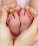 Helsestasjon_små ben i hender