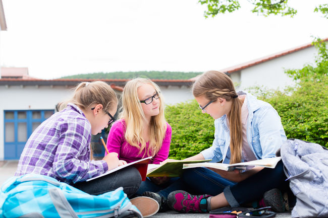 Students doing homework for school together