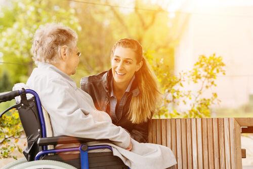 woman visiting grandmother in nursing home