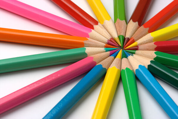 Colorful crayons arranged in circle