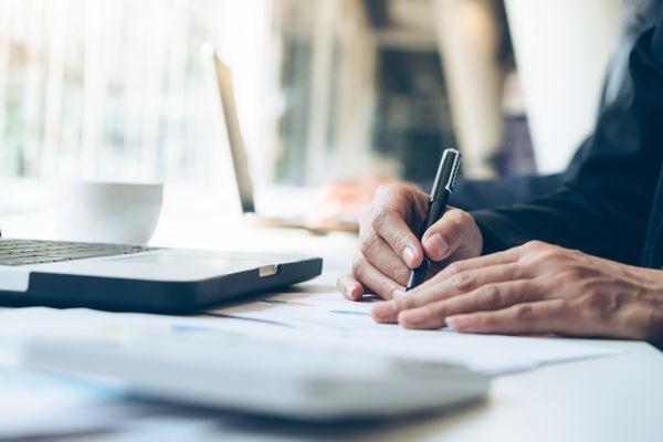 Business people analyse high performance marketing data.