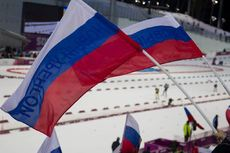 22.02.2014, Sochi, Russia (RUS): Event Feature: Russian flags with Athletes competing on the track- XXII. Olympic Winter Games Sochi 2014, biathlon, relay men, Sochi (RUS). www.nordicfocus.com. © NordicFocus. Every downloaded picture is fee-liable.