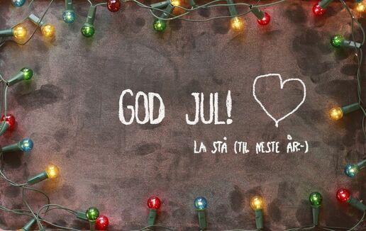God jul på tavla med lys rundt