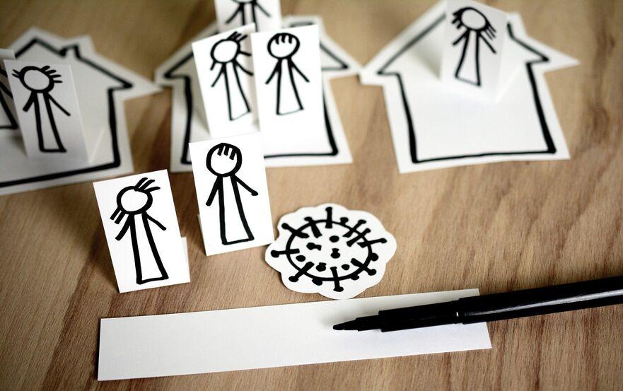 Tegning av koronavirus og mennesker inne i hus